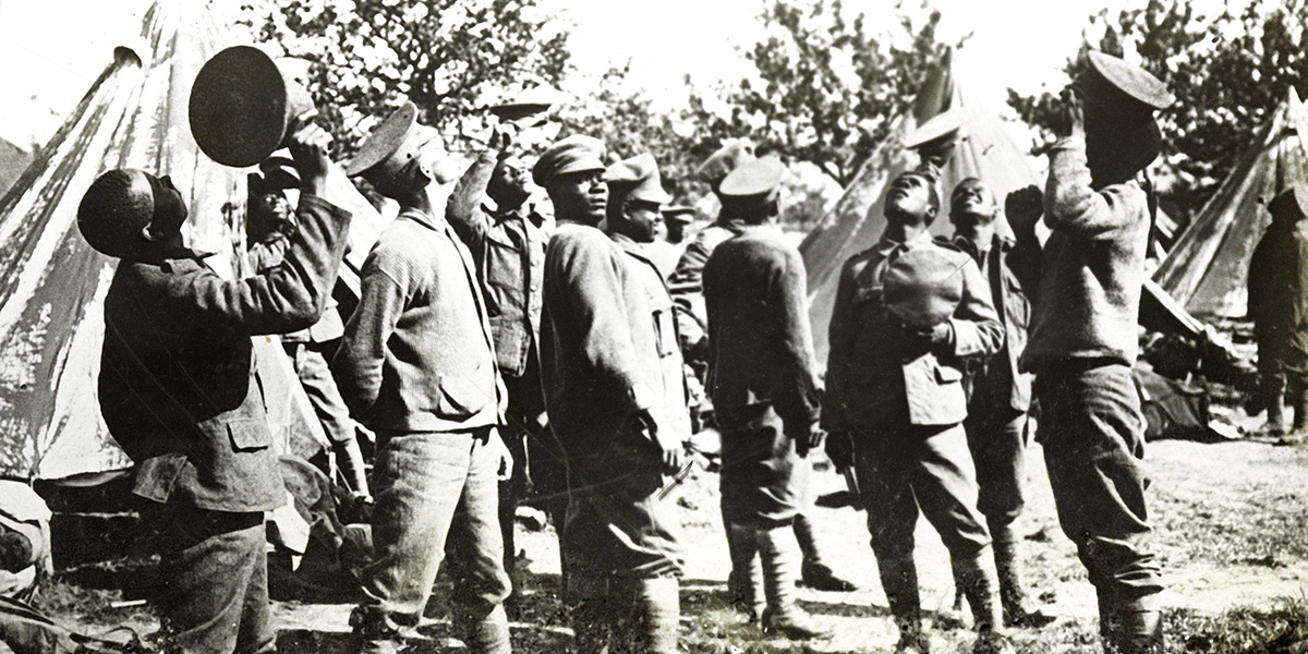 Members of the British West Indies Regiment watching aircraft, 1918