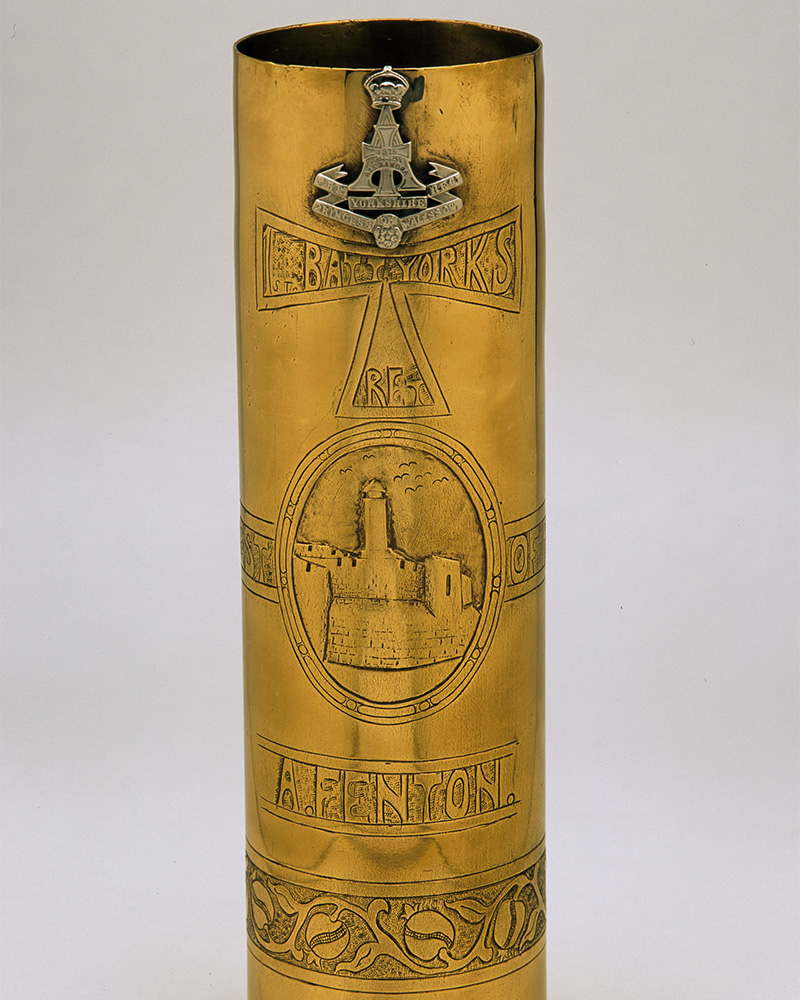 Shell case decorated with insignia of the Green Howards, c1918
