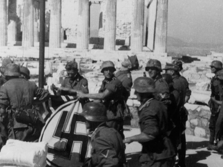 German soldiers raise the swastika at the Acropolis, Athens, April 1941