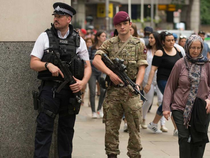 A soldier and policeman patrol London, 2017