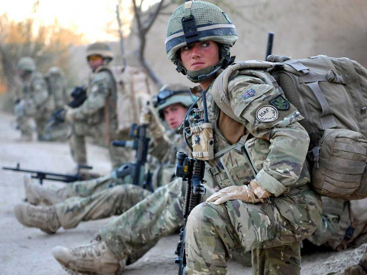 Private Laura Docherty, Royal Army Medical Corps, on patrol with the Royal Irish Regiment in Helmand, 2010