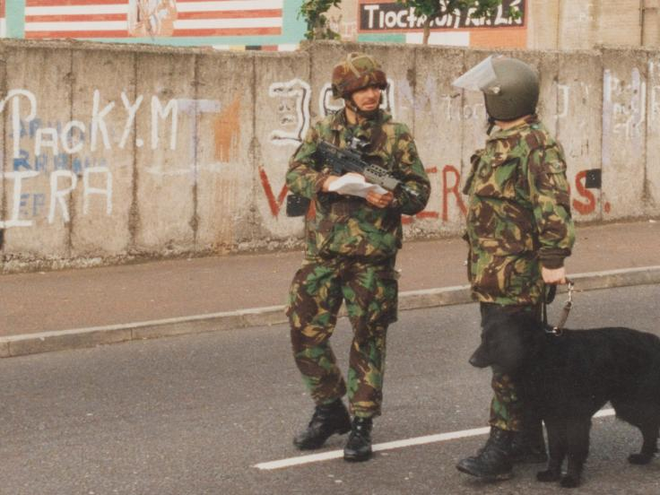 A bomb disposal officer and infantry officer patrol West Belfast, 1992