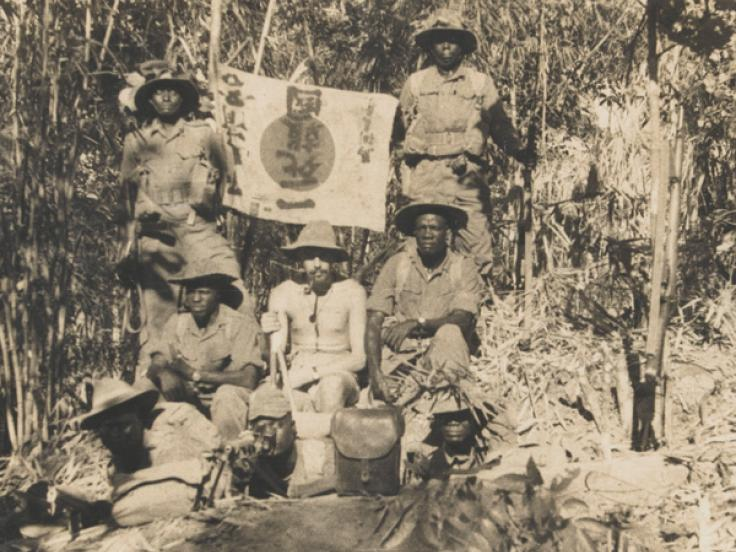 East African soldiers with a captured Japanese flag, 1944