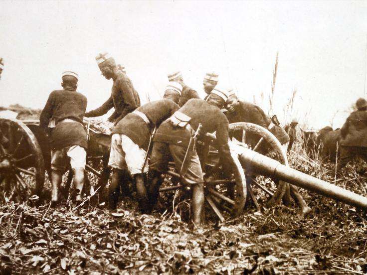 Askaris moving a field gun into position, c1914