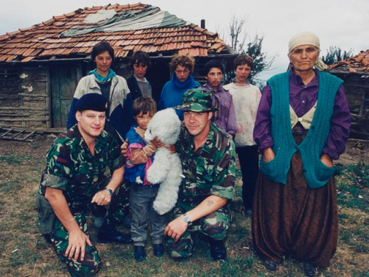 Soldiers with a refugee Kosovo Albanian family, 1999