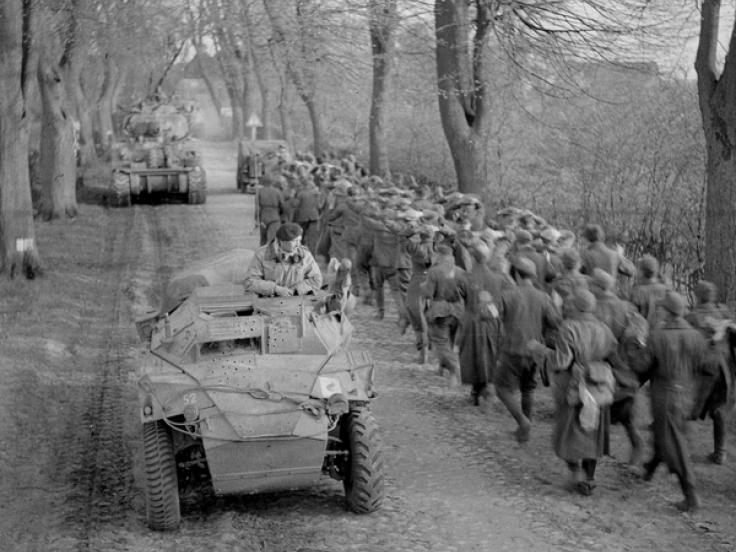 Passing German prisoners of war when moving up to the Aller, Germany, April 1945
