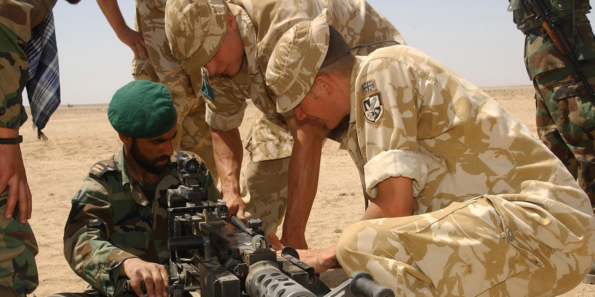 Members of The Parachute Regiment demonstrate the .50 Cal Browning machine gun to Afghan National Army soldiers, 2006