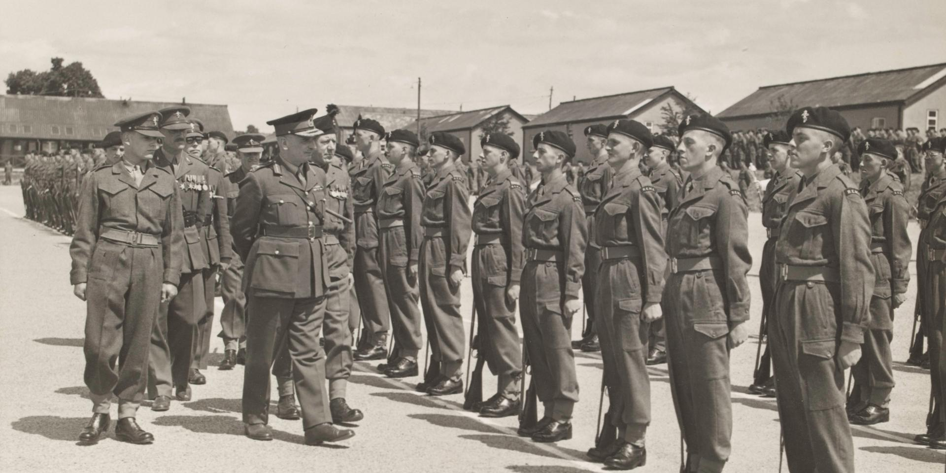 Major-General S W Joslin inspecting the passing out parade of 'C' Company, Royal Electrical and Mechanical Engineers, Honiton Camp, 1952