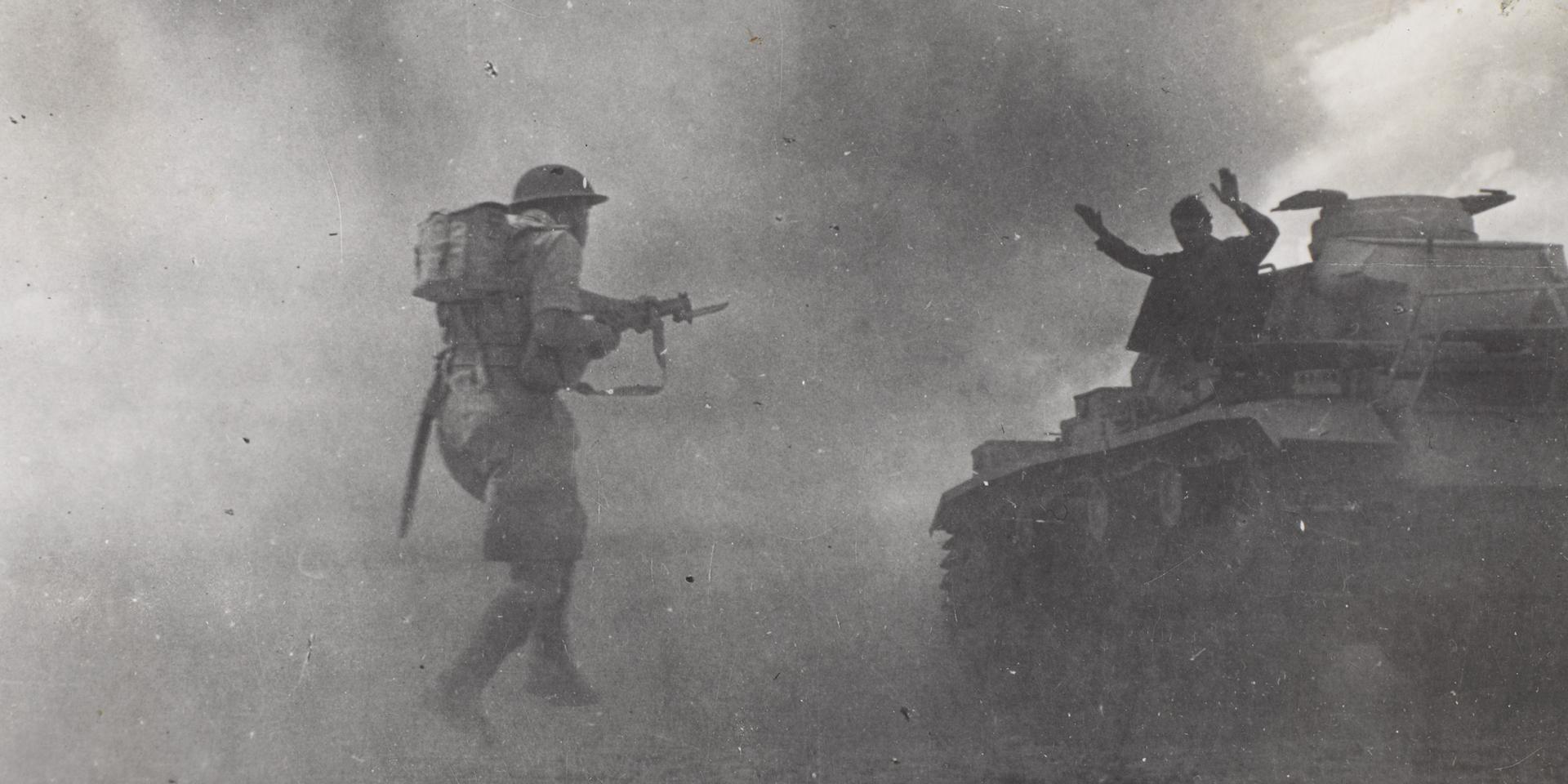   A British infantryman capturing a German tank crewman at El Alamein, 1942  