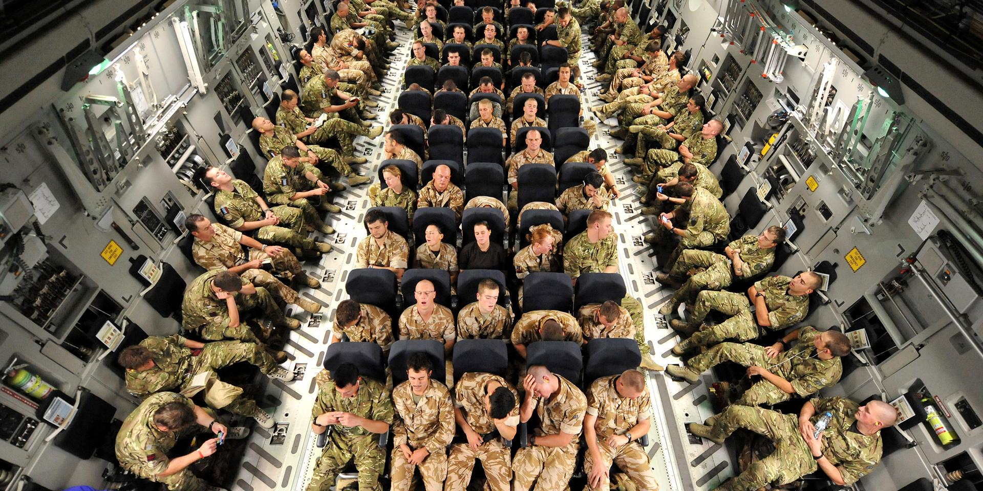 Soldiers on the final leg of their flight to Afghanistan, 2010