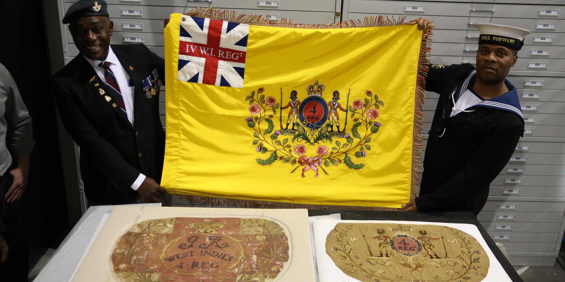 Workshop participants with their replica of the 4th West India Regiment flag