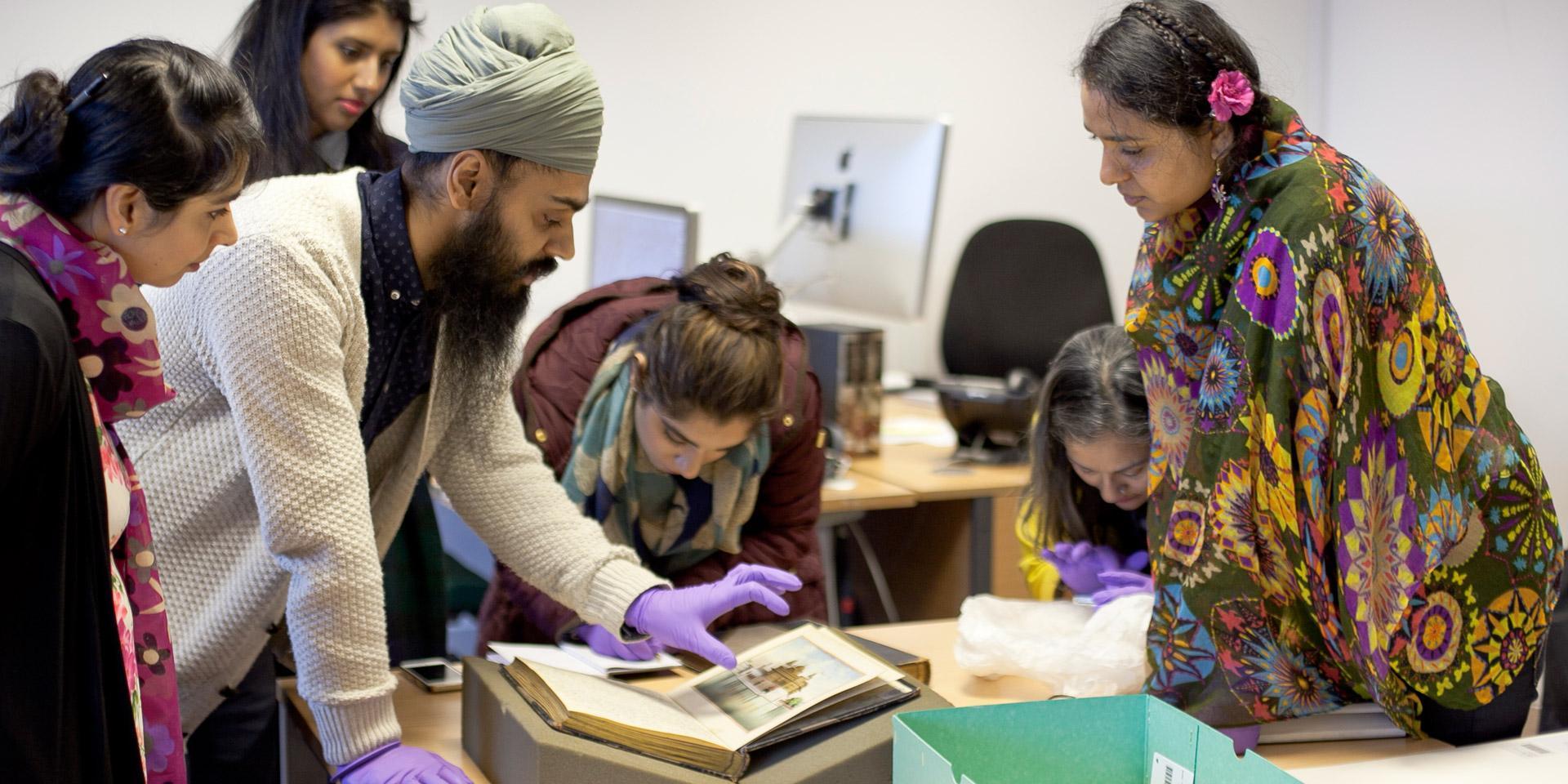 Workshop participants explore collection items