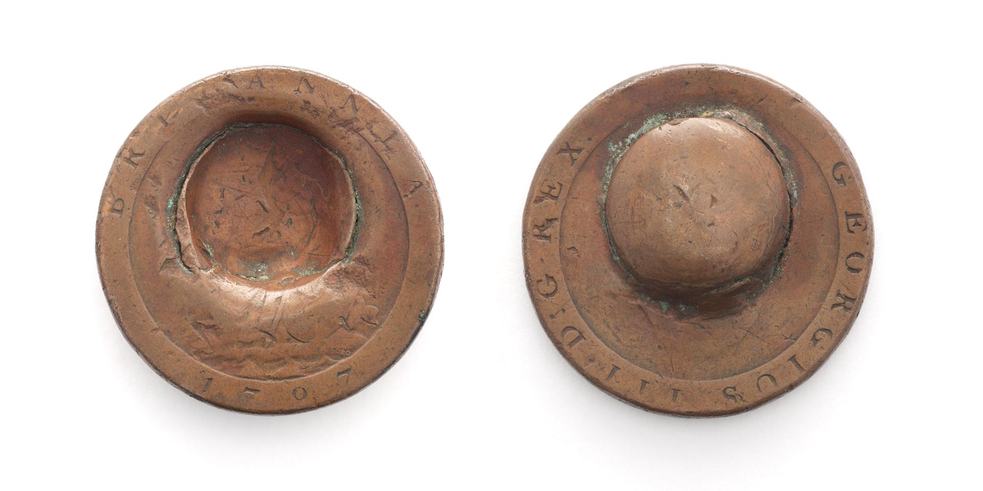 Front and back of a penny dented by a musket ball during the Battle of Waterloo, 1815