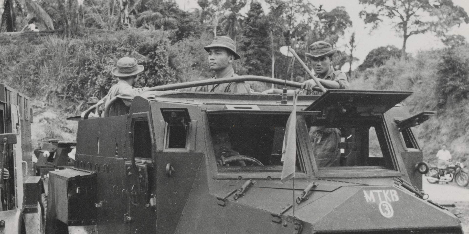 Malayan police in an armoured car, 1952