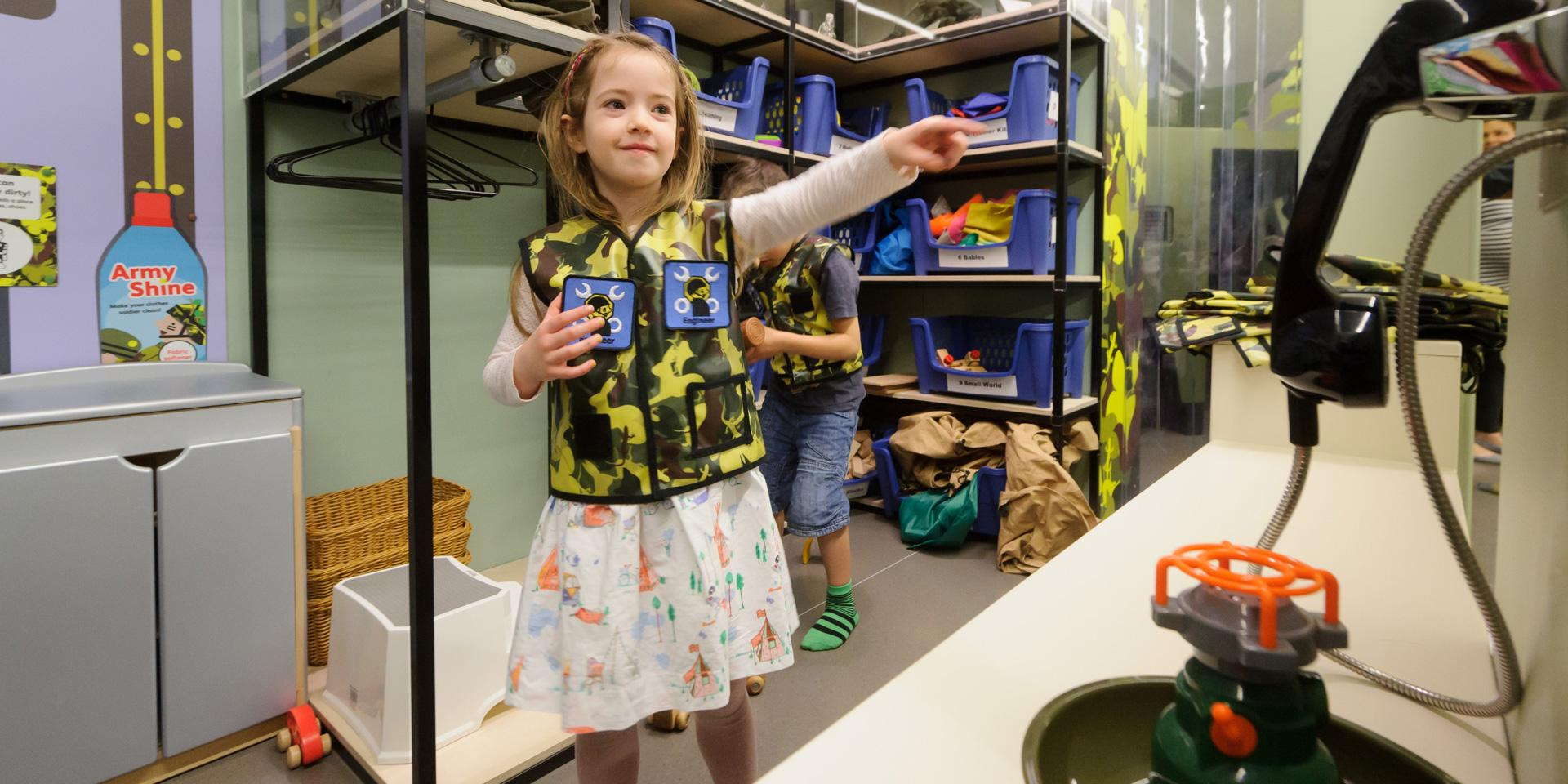 A child in the Play Base quatermaster store