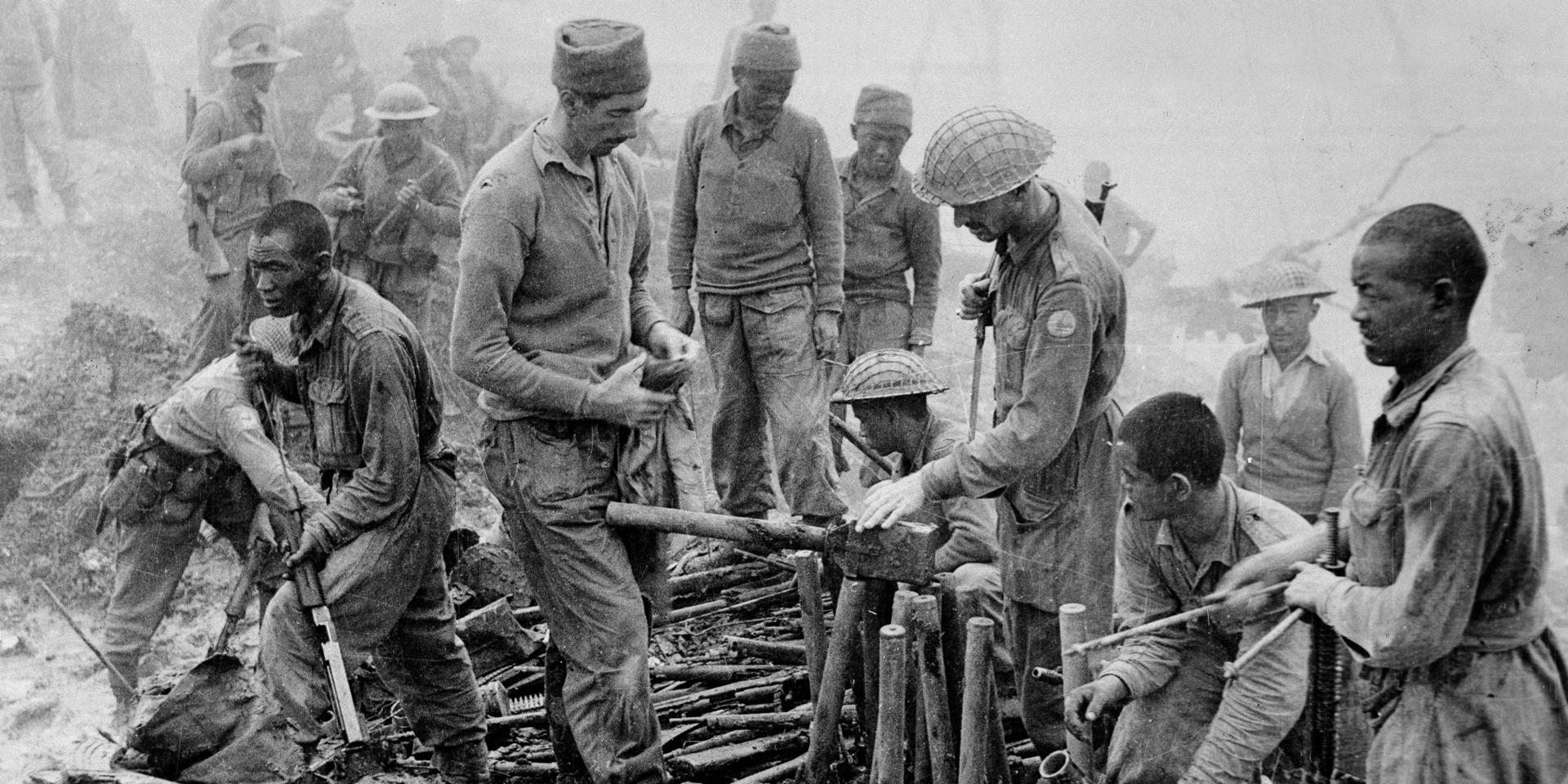 Gurkhas inspect captured Japanese ordnance during the Imphal-Kohima battle, 1944