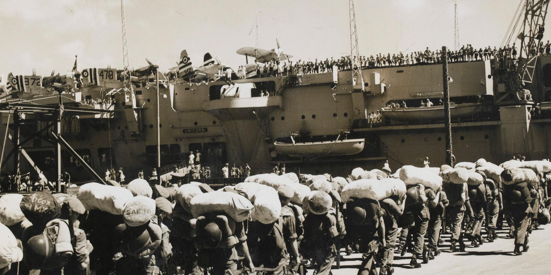 British troops board HMS Unicorn at Hong Kong for the voyage to Korea, 25 August 1950