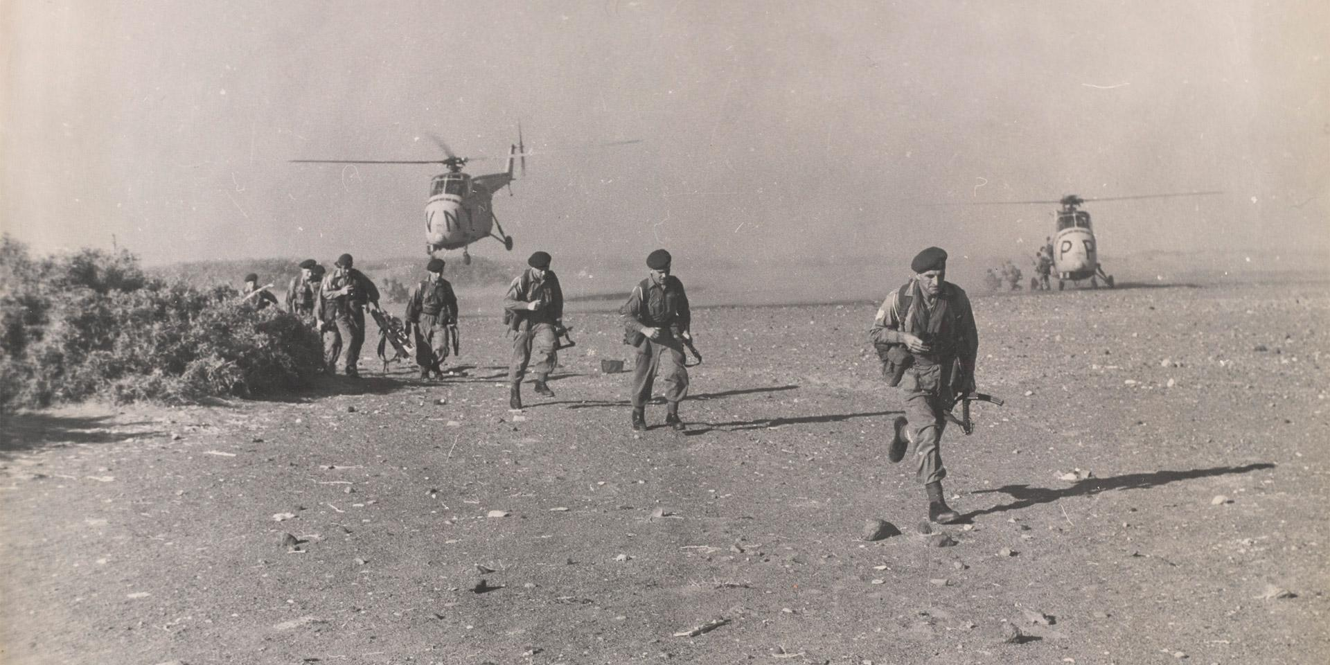 Troops disembark from helicopters, 1964