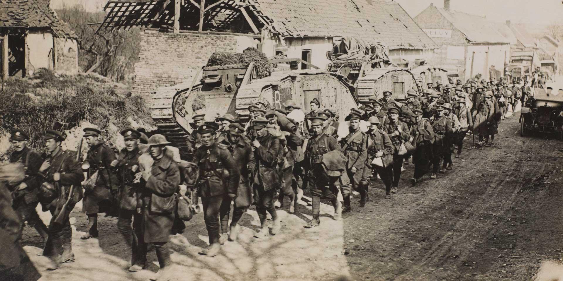Troops passing tanks, 1918