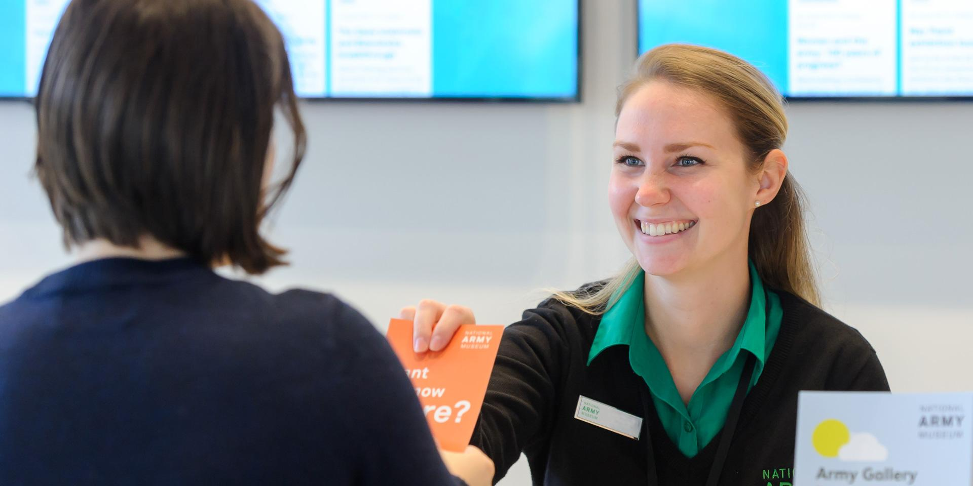 A visitor being greeted by a member of staff.