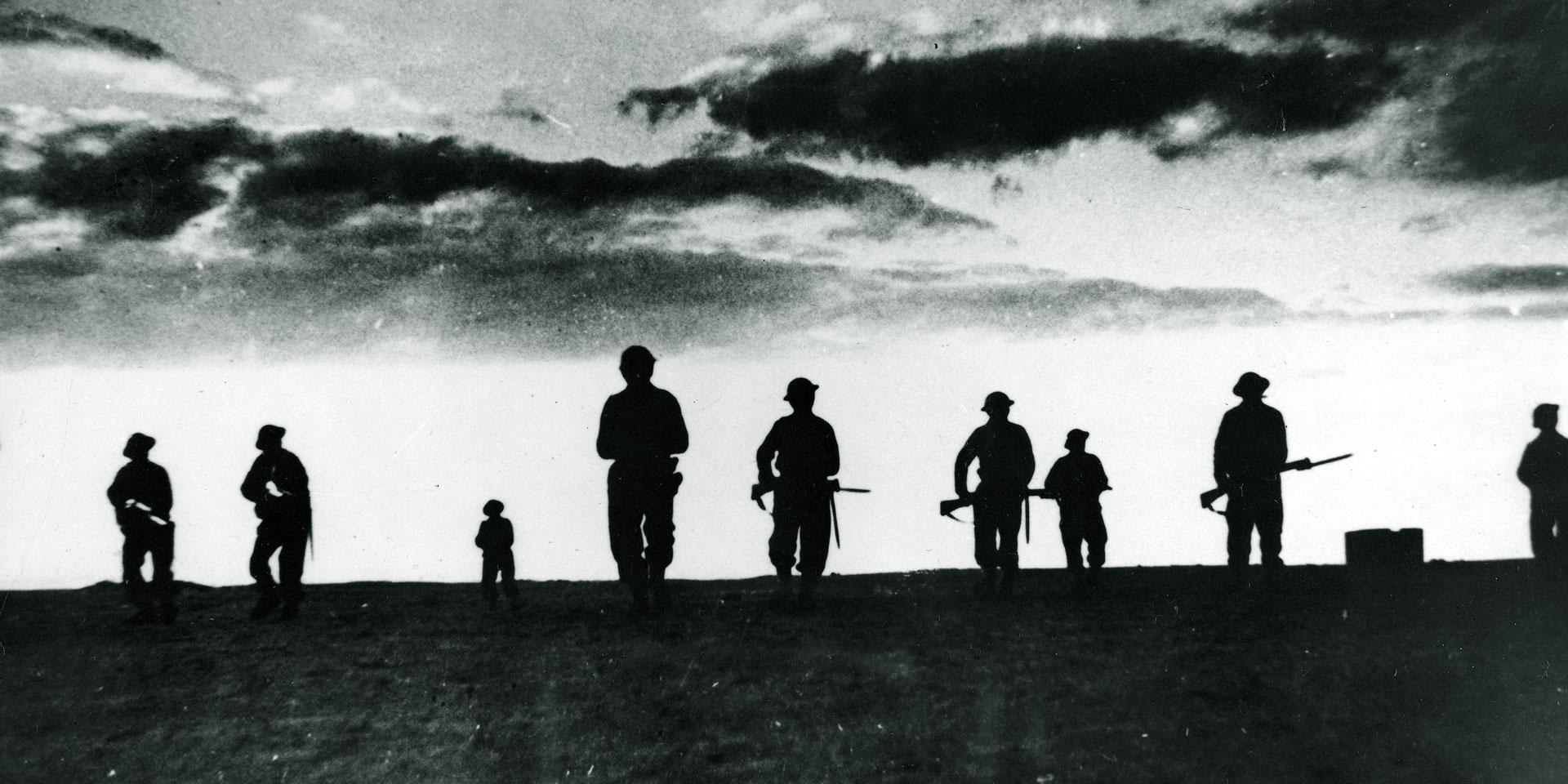 British infantry advancing as darkness falls, El Alamein, 1942