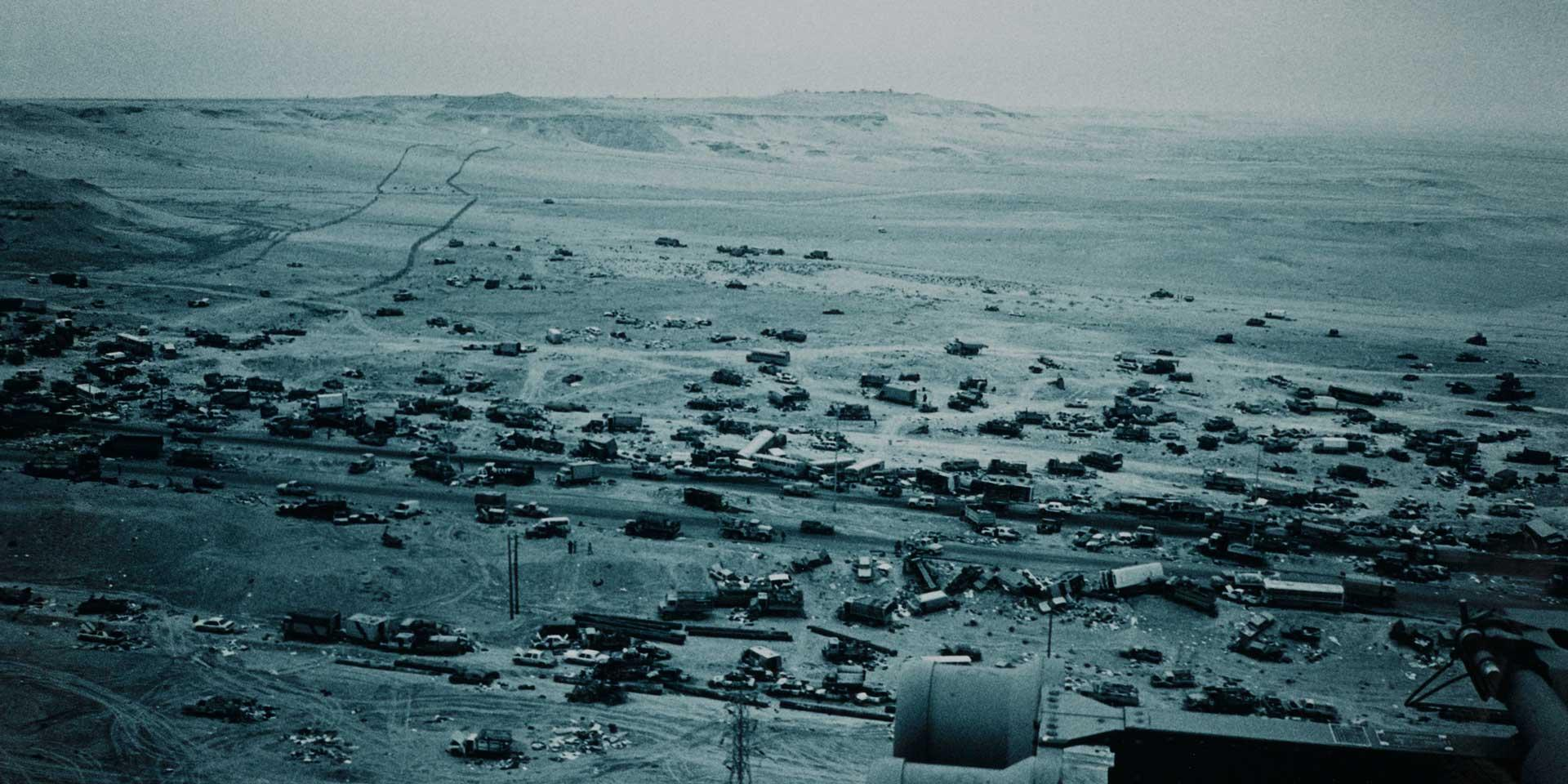 Wrecked military and civilian vehicles on the Basra road, 1991