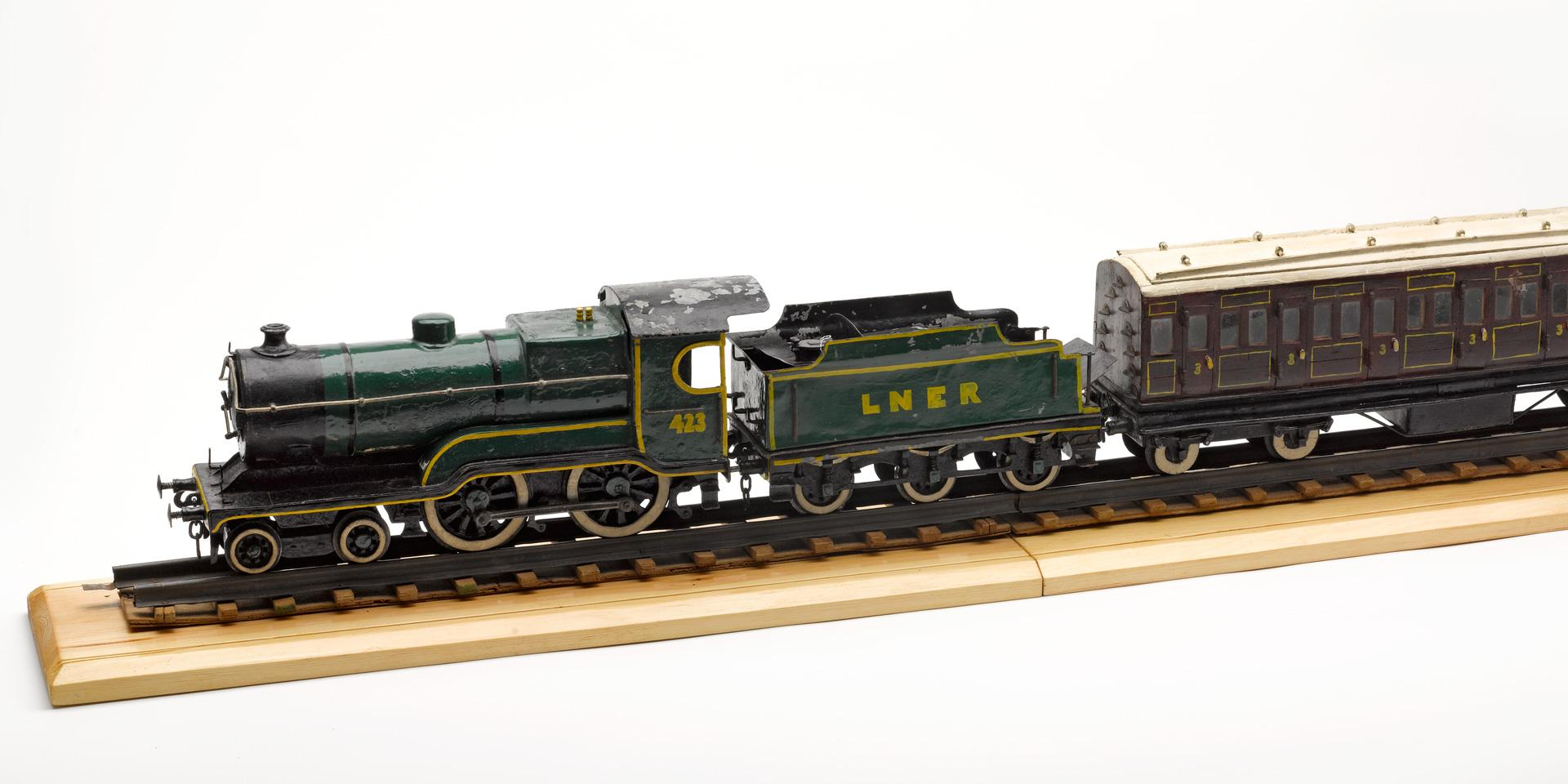 Model of a London and North Eastern Railway engine and carriage, c1943
