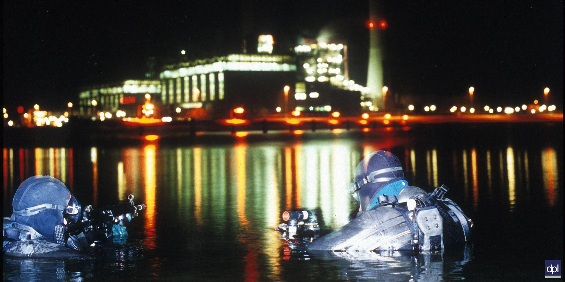 Swimmer canoeist divers pictured during a night-time exercise, c2000