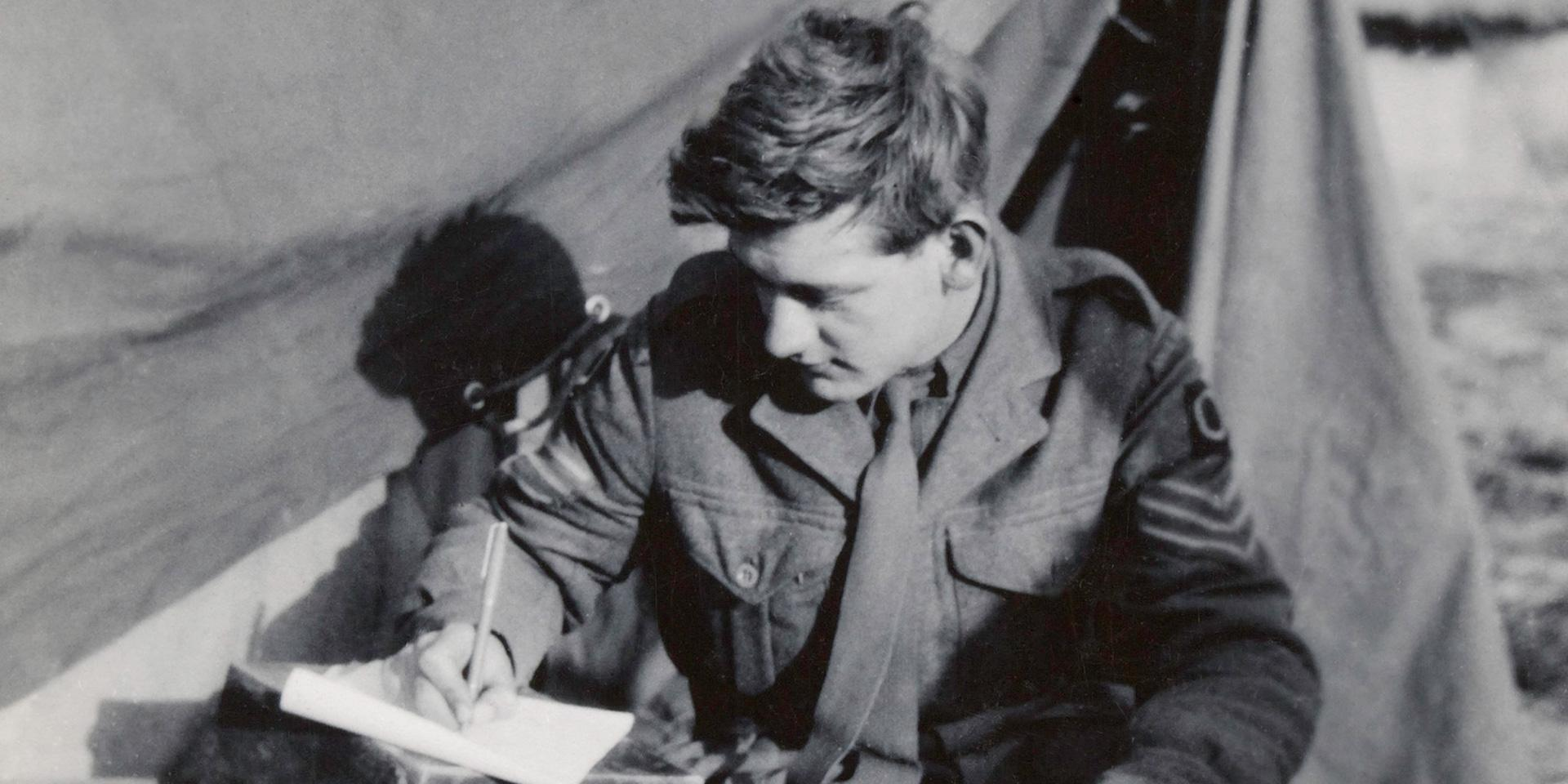 Sergeant Anthony Baker writing a letter during his service in Korea