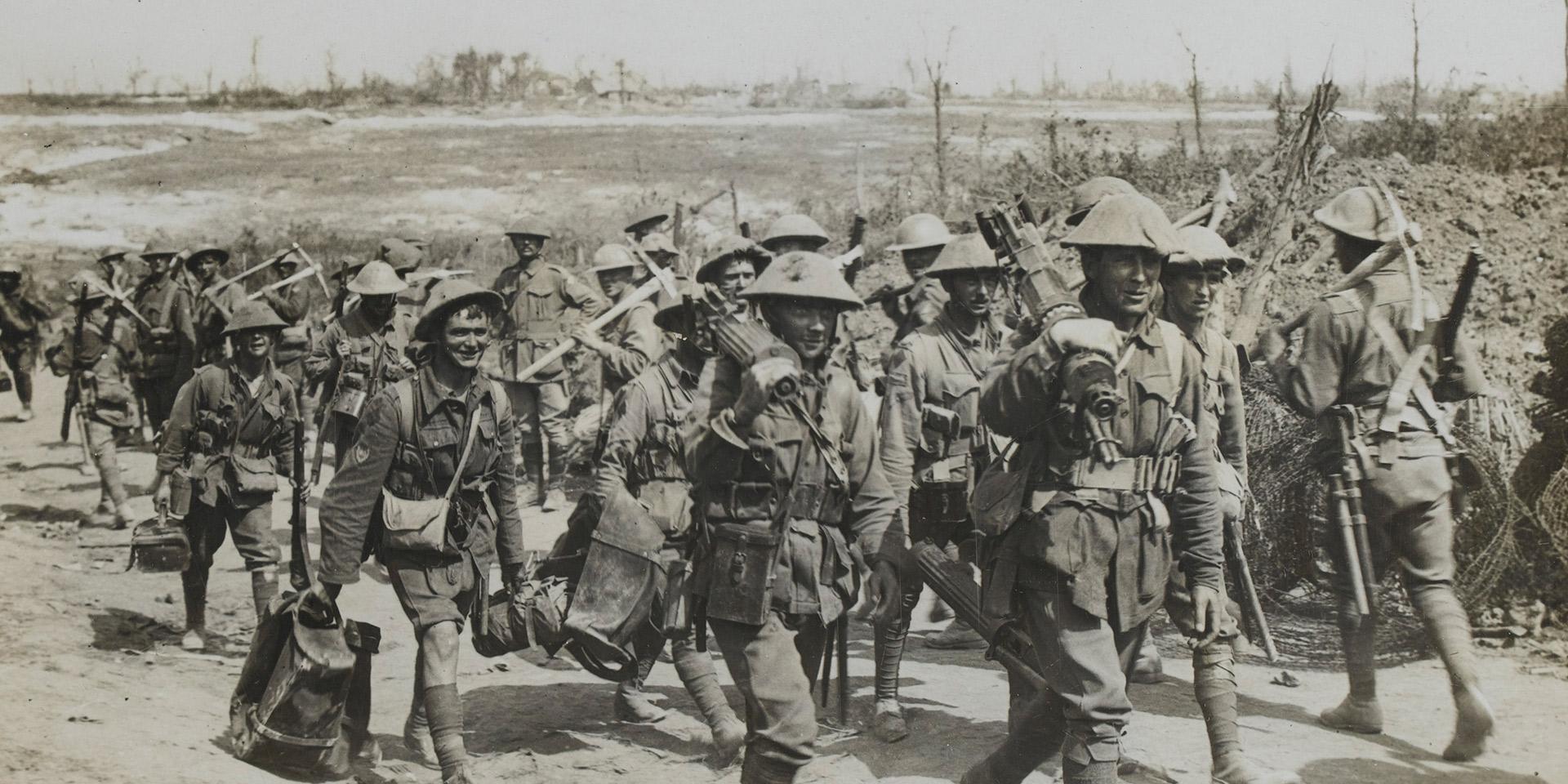 Australian machine gun team passing a working party, 1916