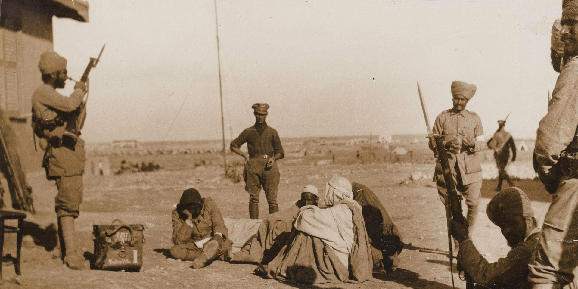 Indian Army soldiers stand guard over wounded Bedouin at Mersa Matruh, 1915