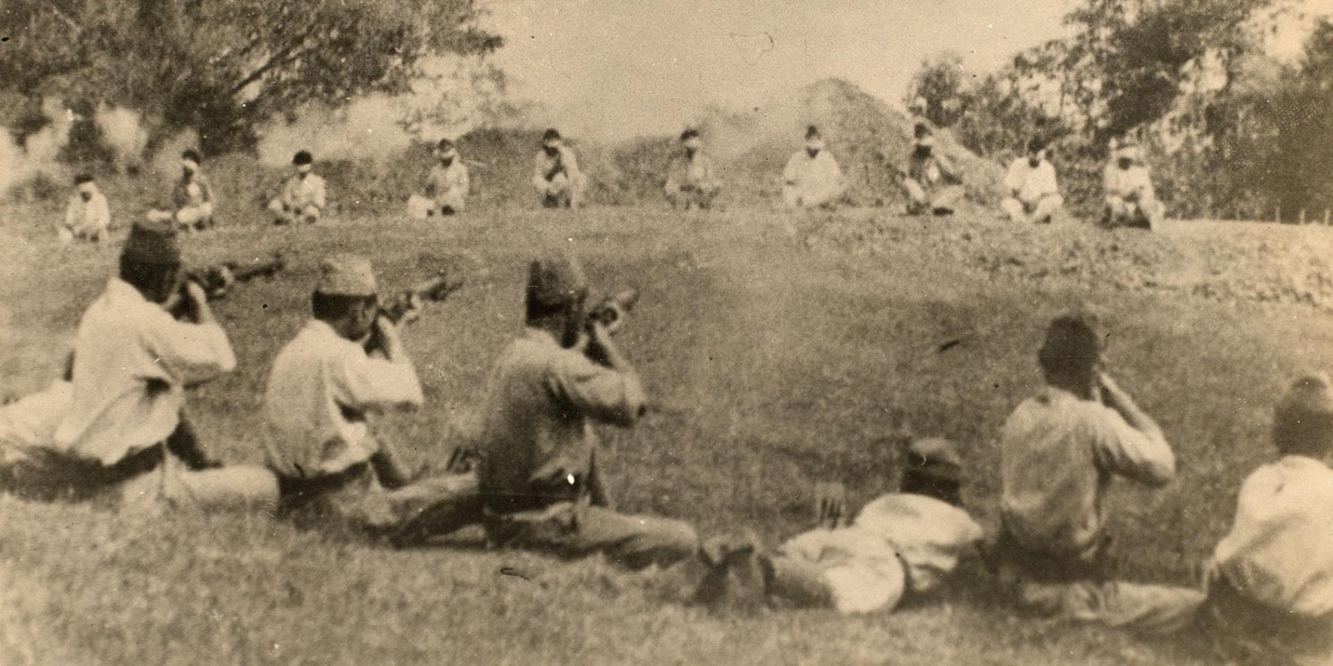 Japanese soldiers executing Indian prisoners of war at Singapore, 1942
