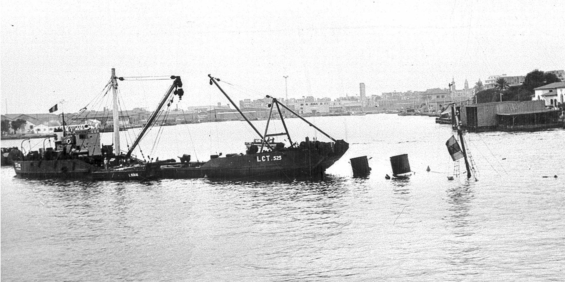 Royal Engineers on a LCT checking sunken shipping blocking the canal, 1956