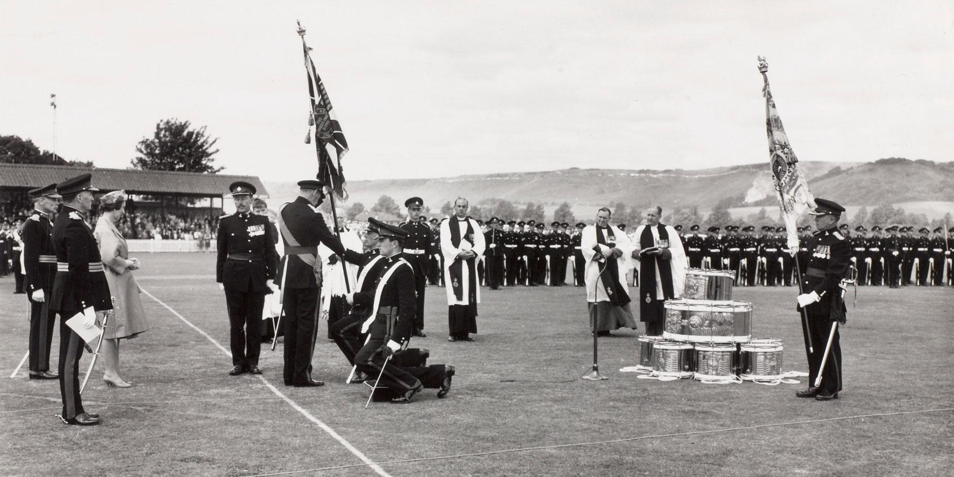 King Frederick IX of Denmark presenting colours to The Queen's Own Buffs, Royal Kent Regiment, 1962