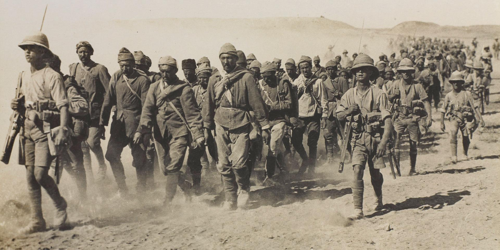 Turkish prisoners escorted by the 1/5th Queen's Own (Royal West Kent) Regiment, Mesopotamia, 1917