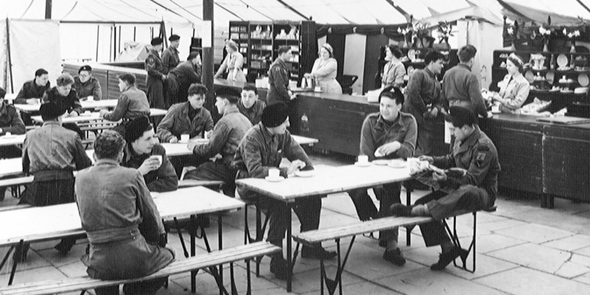 National Servicemen relax in the NAAFI canteen at Weybourne Camp, April 1954