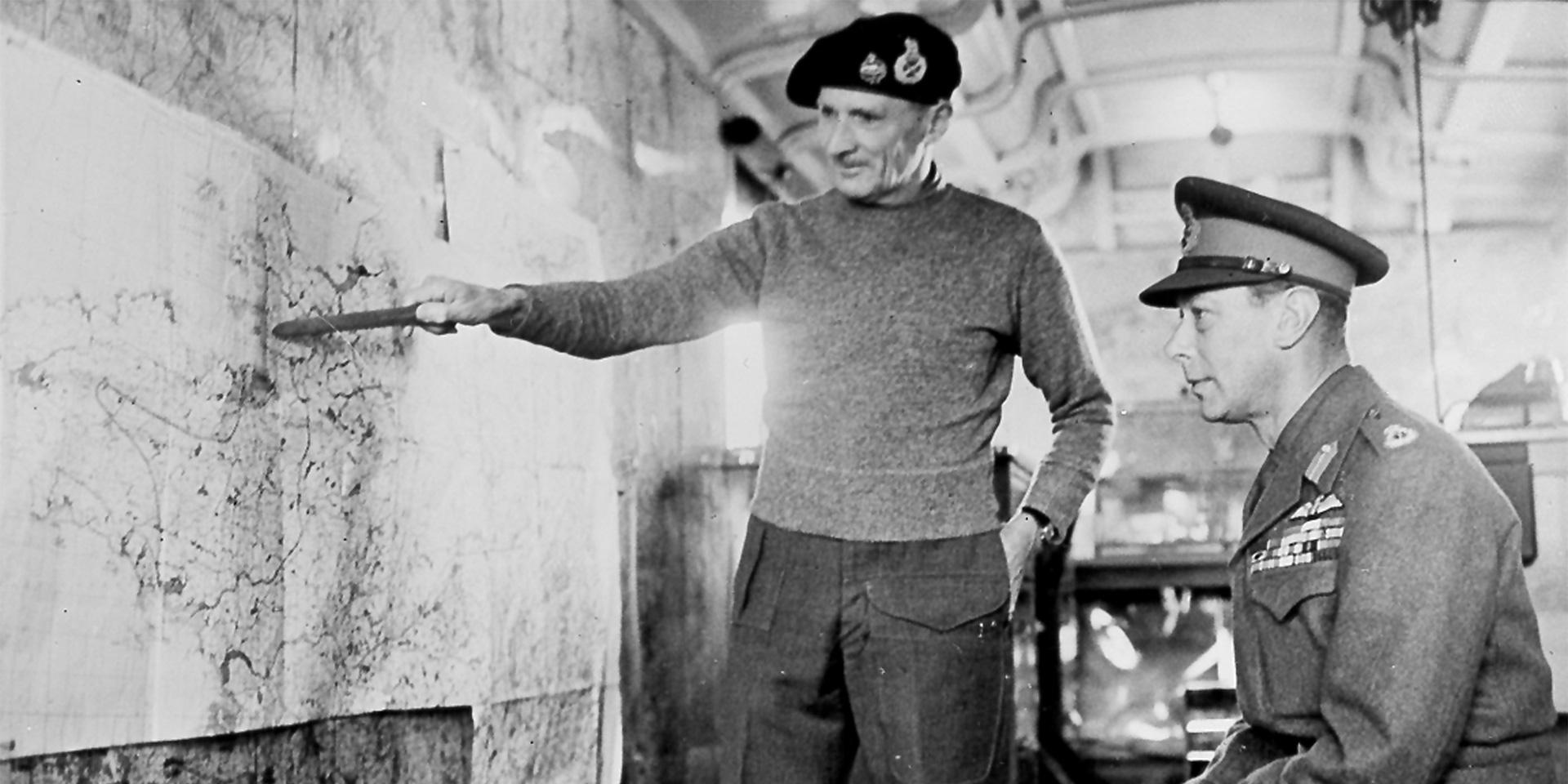 Montgomery explaining his plans to King George VI inside Monty's map caravan in 1944