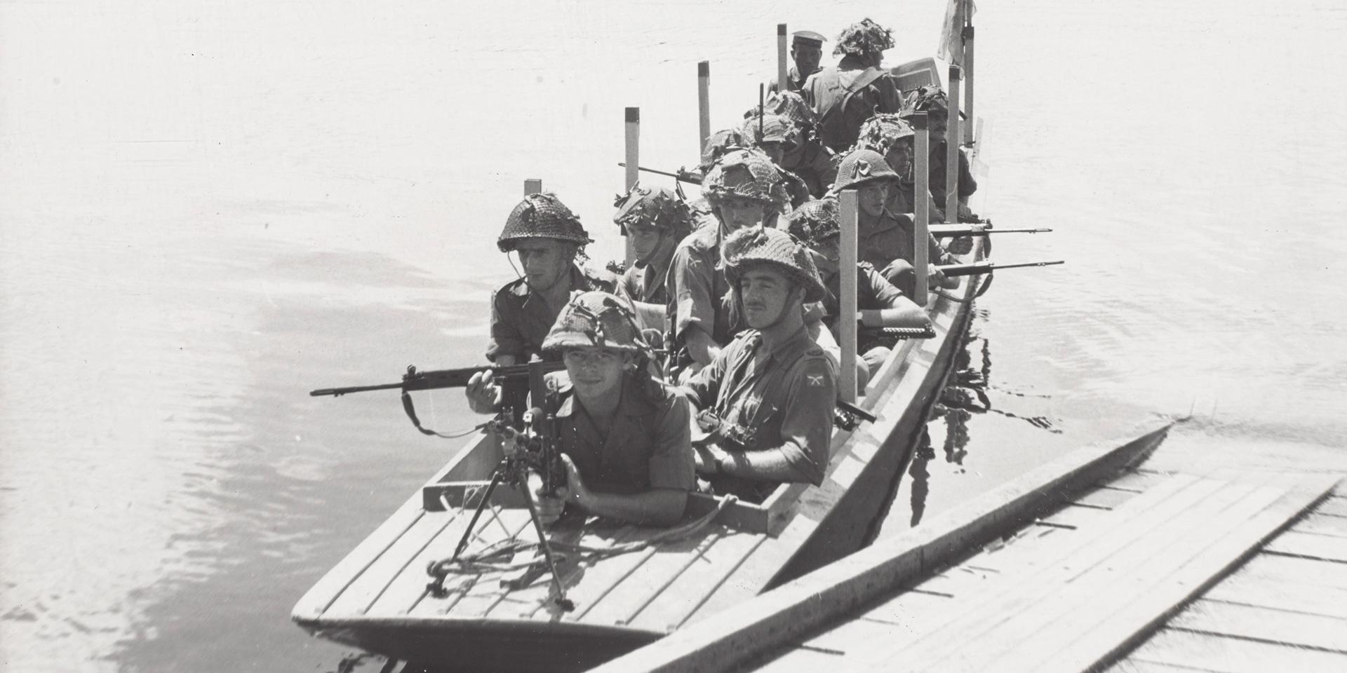 Members of 1st Battalion The Queen's Own Highlanders on river patrol in Brunei, 1962