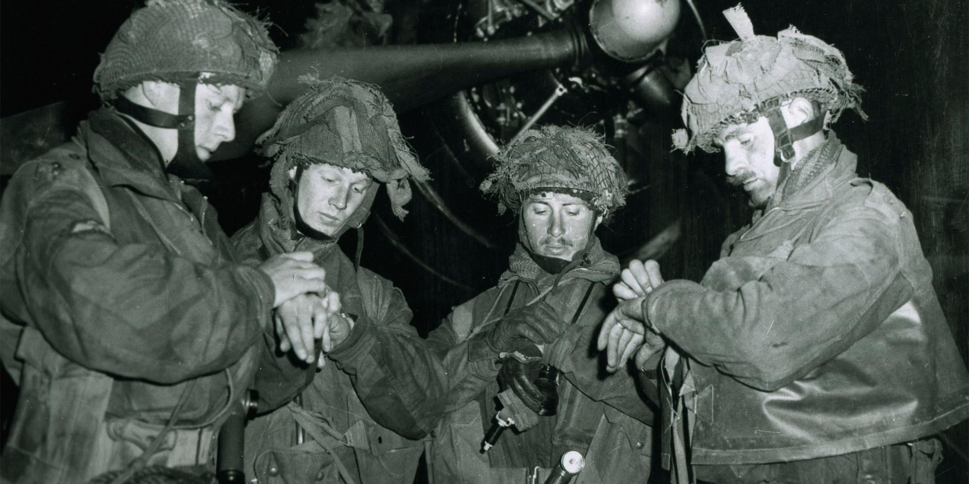Airborne Forces synchronising their watches before the invasion