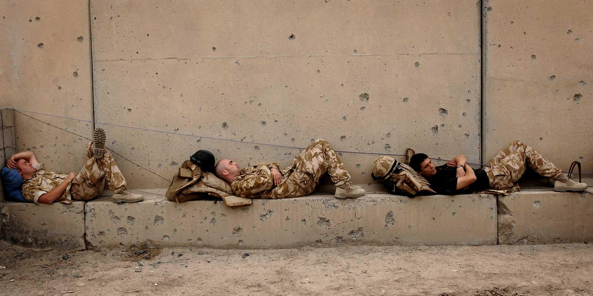 Troops from 1st Battalion The Staffordshire Regiment rest after a patrol in Basra, 2007