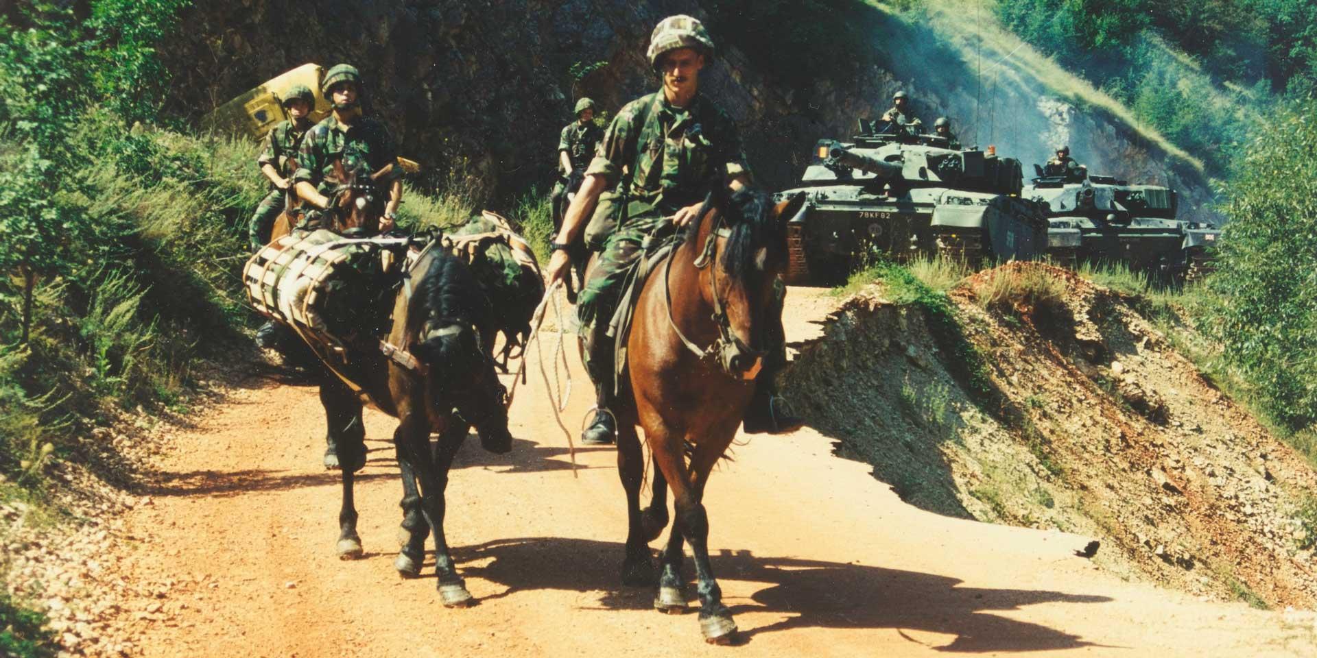 King's Royal Hussars on mounted patrol alongside their Challenger tanks, Mrkonjic Grad, Bosnia, 1997