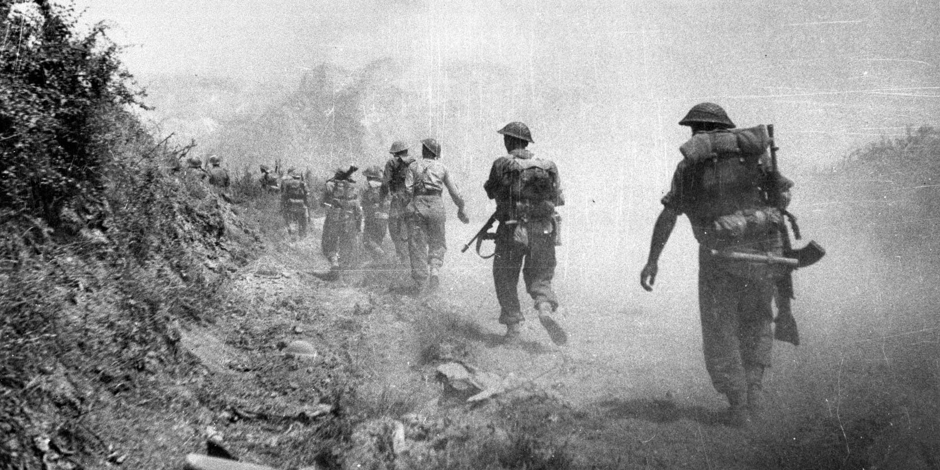 British troops moving through a smoke screen past Monastery Hill into Cassino, Italy, 1944