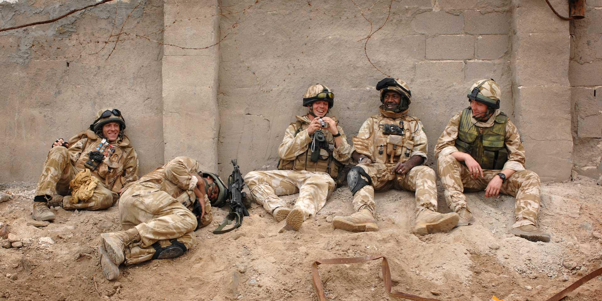 Soldiers of the Royal Green Jackets take a break during Operation Sinbad in Basra, February 2007