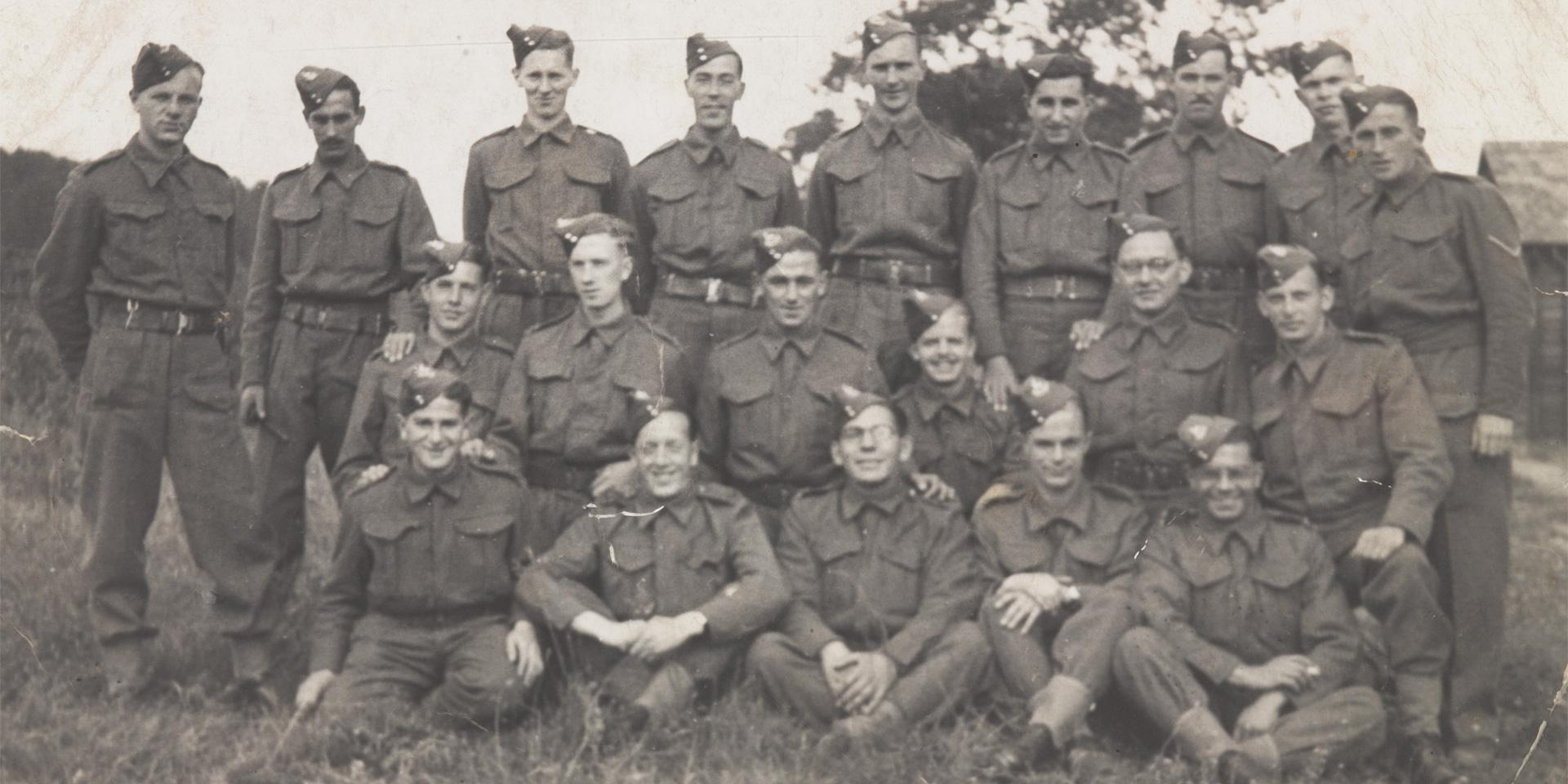 Private Abram Games (seated far right of middle row) with soldiers of The Royal Warwickshire Regiment, 1940