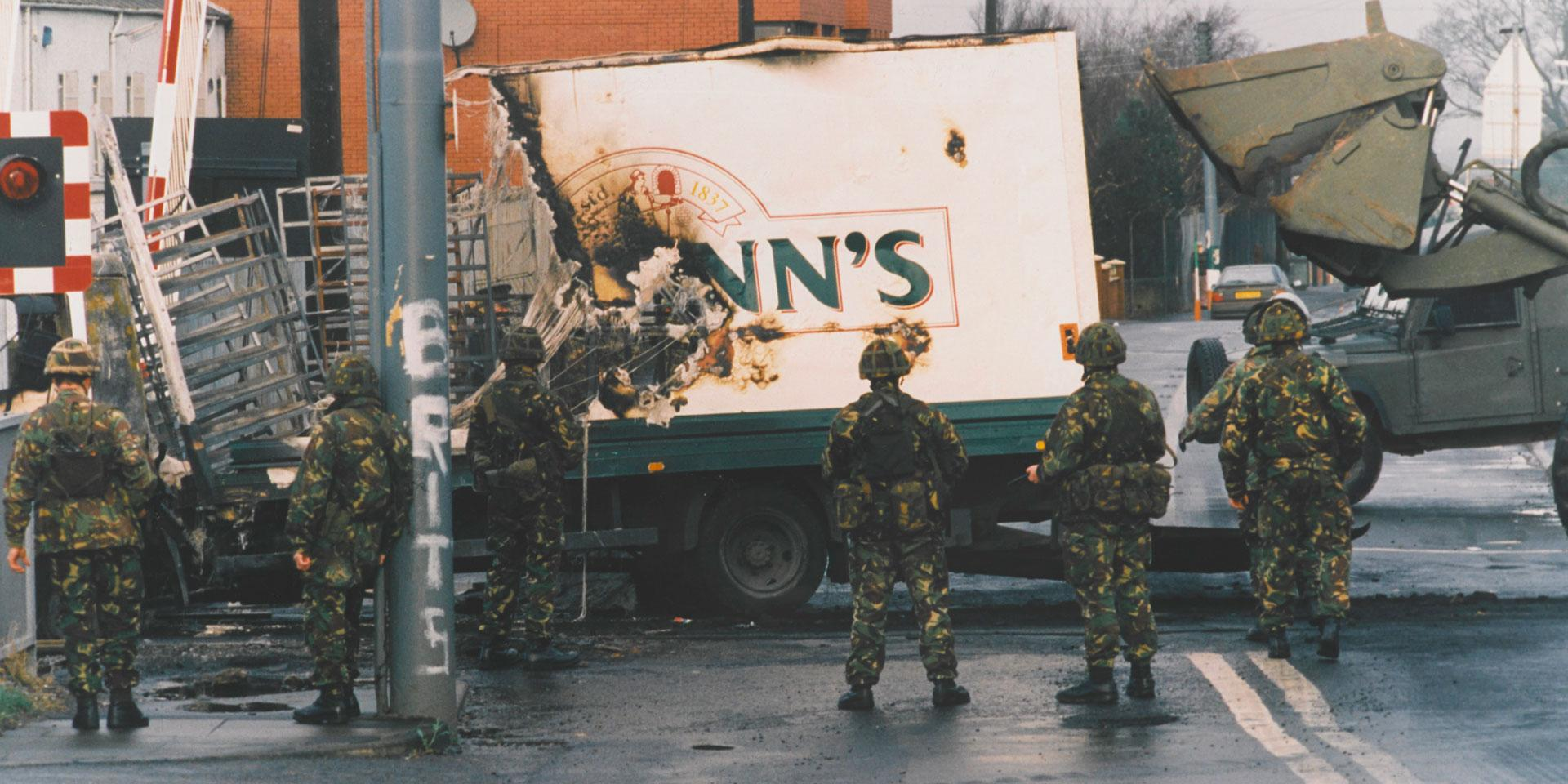 Soldiers of the Ulster Defence Regiment at the scene of a bomb attack, c1990