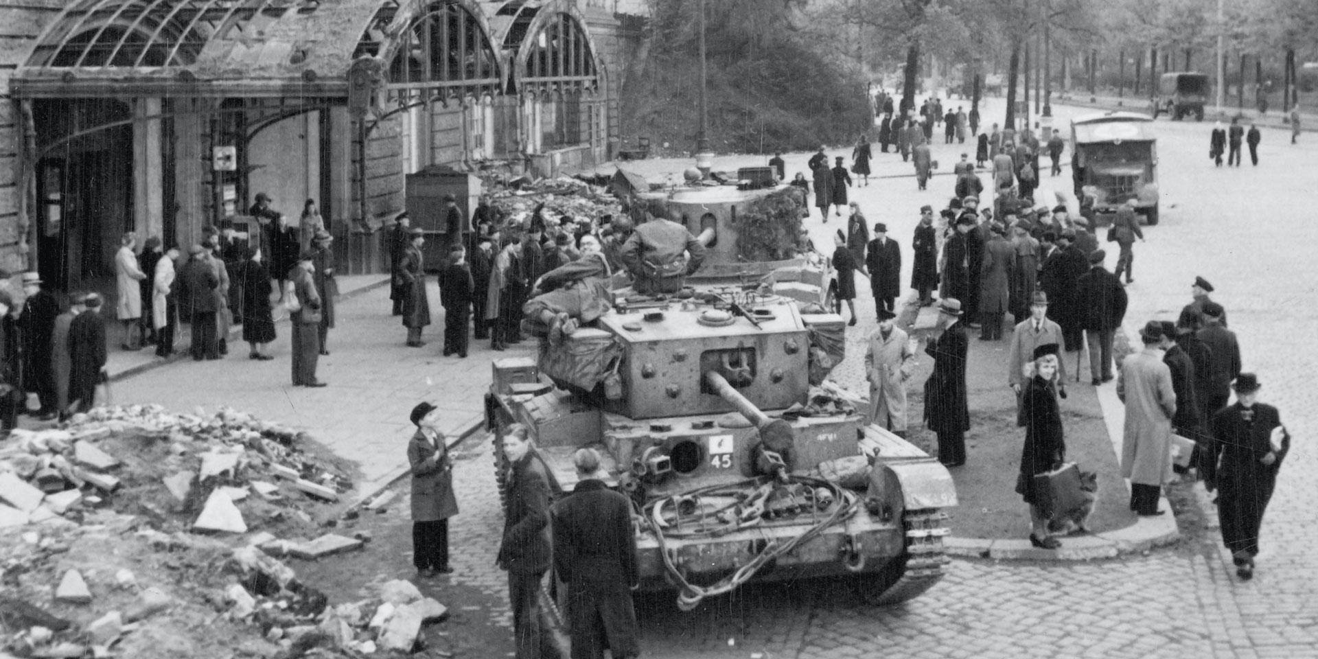 Civilians gather around British tanks outside Hamburg rail station, May 1945
