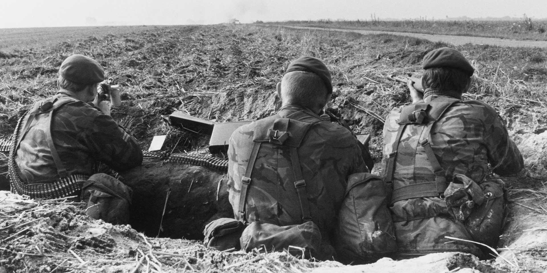 British soldiers dug-in by the side of a road during an exercise in West Germany, 1979