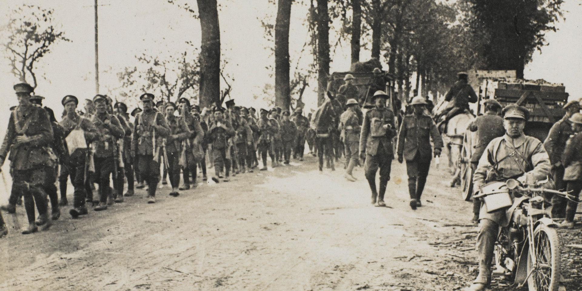 Troops of the Manchester Regiment marching to the front line, July 1918