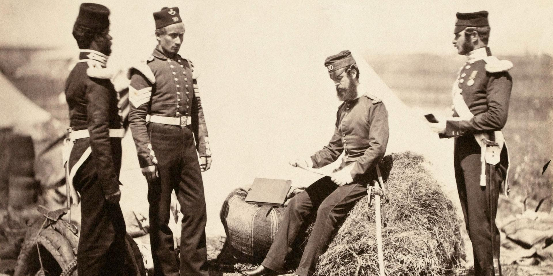 Captain Mark Walker VC (seated) with colleagues from the 30th (Cambridgeshire) Regiment in the Crimea, 1855