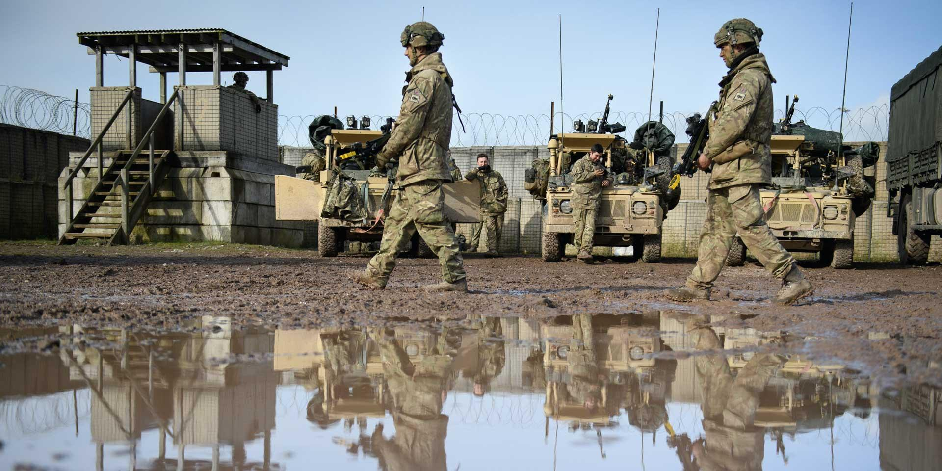 Reconnaissance platoon of 1st Battalion The Royal Welsh move through camp prior to a patrol exercise on Salisbury Plain, 2017